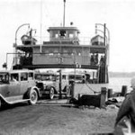 Black and white photograph of the Algoming ferry being loaded with cars